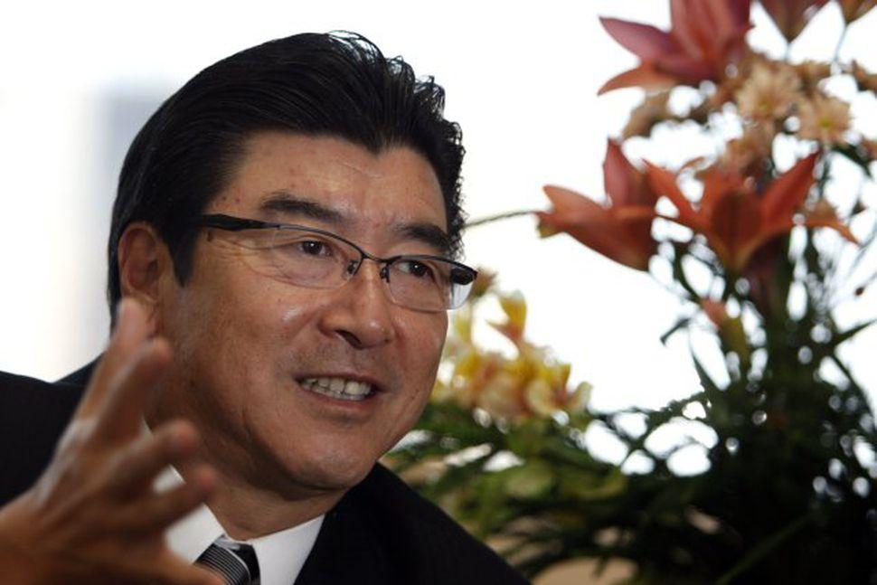 Sakihito Ozawa umhverfisráðherra Japans.