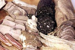 Ram's testicles, here on the left, blóðmör (blood pudding), harðfiskur ( dried fish), rúllupylsa ( ...