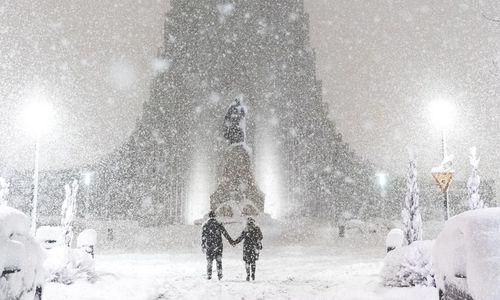 Hallgrímskirkja church, one of the city's landmarks, dusted with snowflakes.