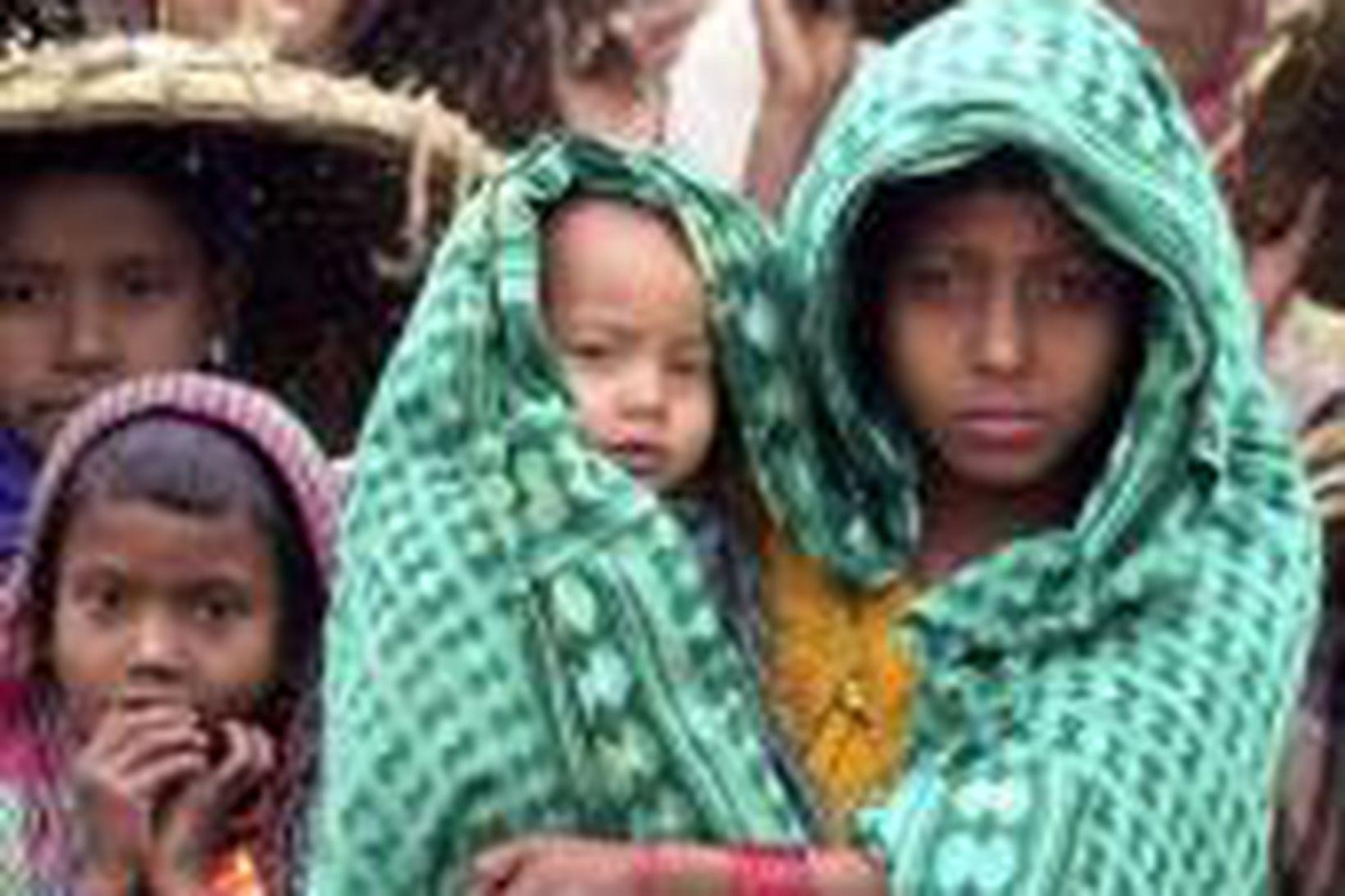 Heimilislaus börn í Dhaka, höfuðborg Bangladesh, í atvinnuleit.