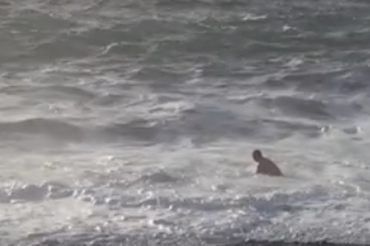The man undressed at the beached and walked into the sea.