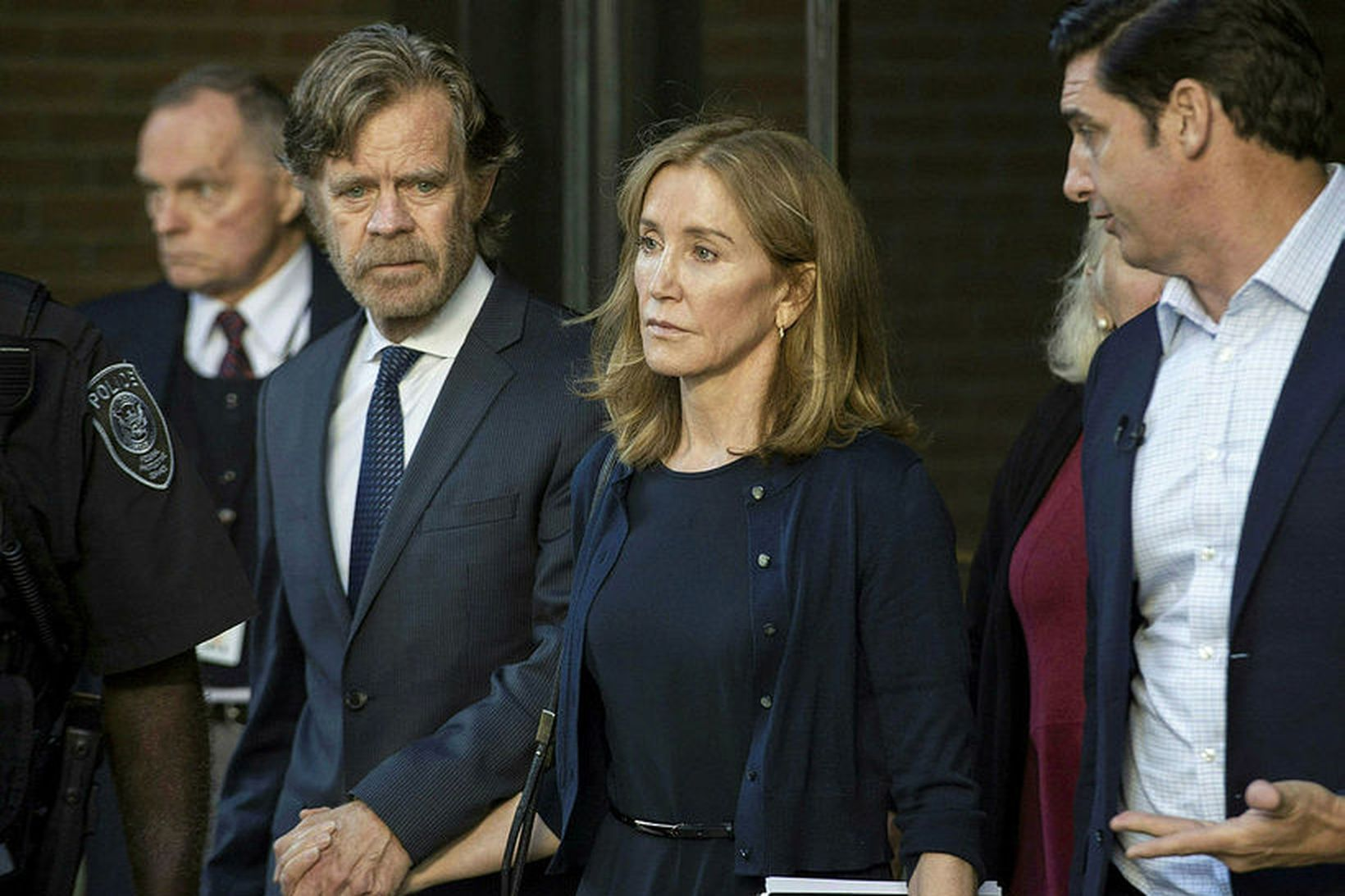 Actress Felicity Huffman, escorted by her husband William H. Macy …