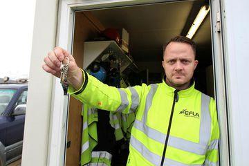Engineer Stefán Geir Árnason, brandishing the key ring whose name is the longest word in ...