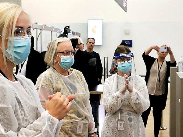 Healthcare workers, ready to test arriving passengers for the coronavirus at Keflavík International Airport.
