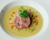 Salted meat and split pea soup are usually served with carrots, rutabega and potatoes.