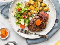 Girnileg ribeye steik með æðislegu hvítlauks-tómatsmjöri.