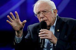 Forsetaframbjóðandinn Bernie Sanders segir kröfuna um hækkun lágmarkslauna ekki fela í sér niðurrif á kerfinu.