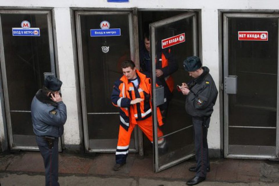 Emergencies Ministry members walk out from Park Kultury metro station in Moscow March 29, 2010. …