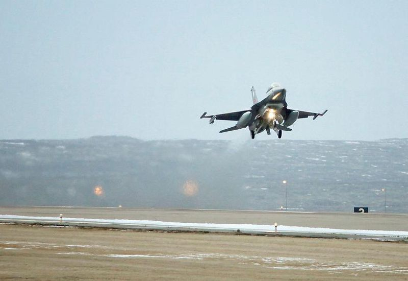 An archive photo, showing a fighter plane taking off at Keflavík Airport.