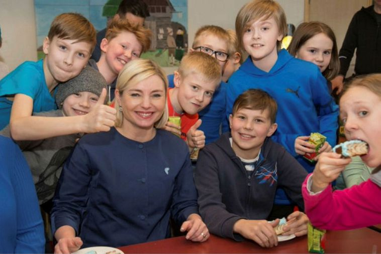 Lilja Alfreðsdóttir surrounded by Icelandic children at the launch of the latest version of Icelandic …