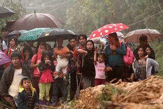 Íbúar í bænum Itogon í Benguet leituðu margir skjóls í kirkju er Mangkhut fór yfir. ...