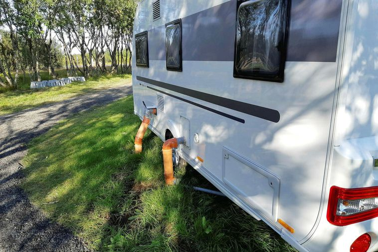 The RVs were connected to the area's sewage system without a proper permit.