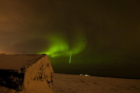 The shooting star, surrounded by northern lights.