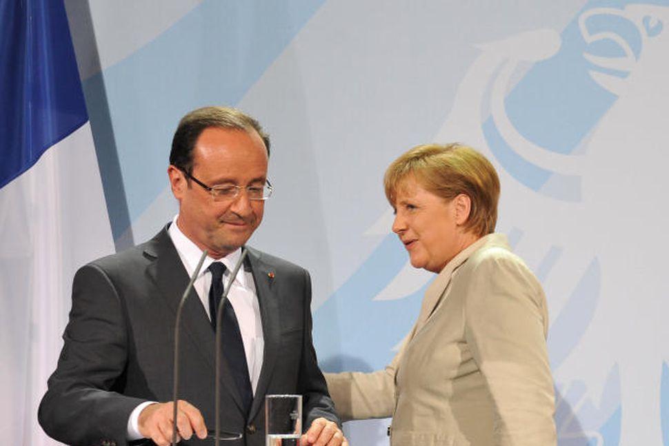 François Hollande og Angela Merkel segjast ætla að gera allt ...