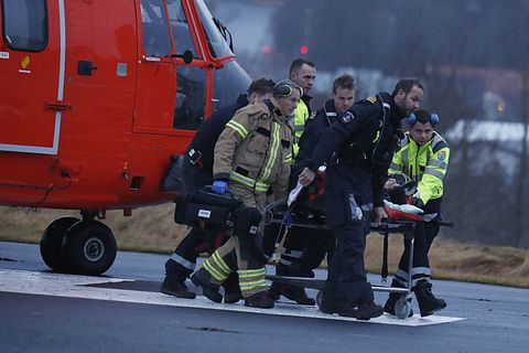 Injured people being transported by the National Coastguard helicopter.