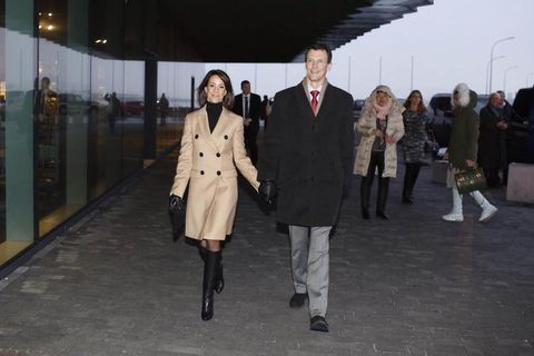 The royal couple entering Harpa concert hall today, designed by Henning Larsen architects and artist Ólafur Elíasson.
