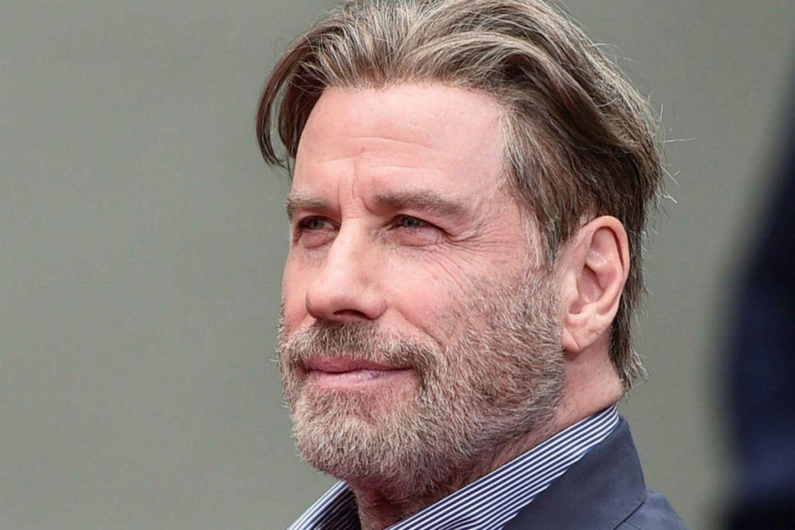 John Travolta var með mikið hár þegar þessi mynd var …
