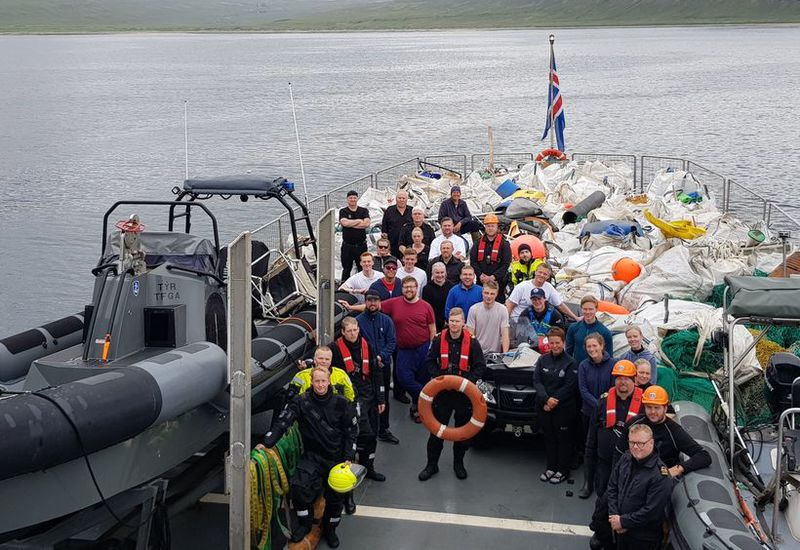 Volunteers and the crew of the Icelandic Coast Guard ship, leaving Barðsvík.
