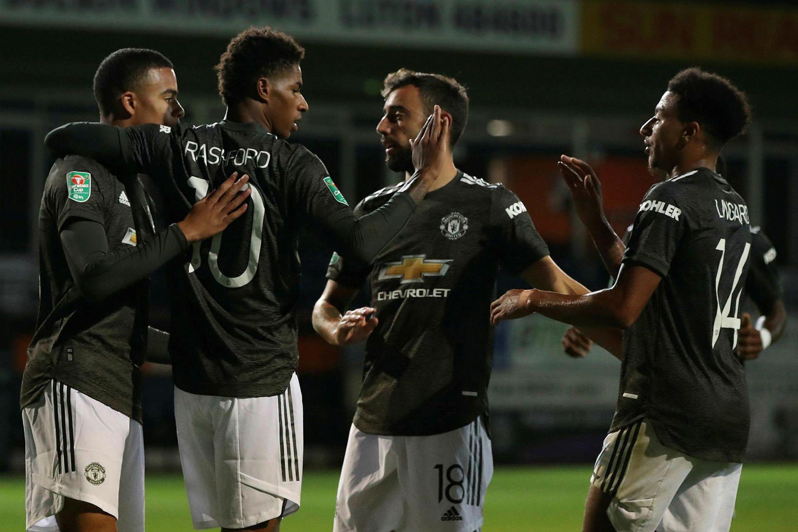 Leikmenn Manchester United fagna í kvöld.