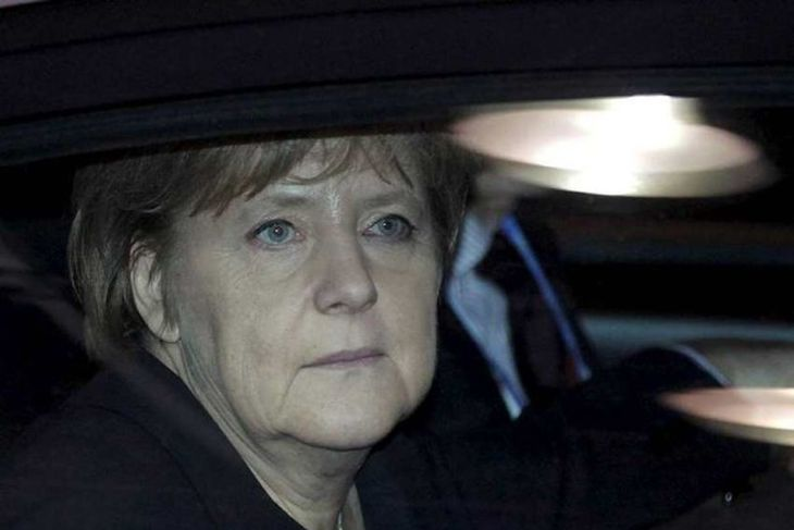 Germany's Chancellor Angela Merkel arrives at an European Union summit in Brussels December 8, 2011. ...