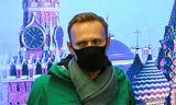 Alexei Navalní á flugvellinum í Rússlandi í gær skömmu áður en hann var handtekinn.