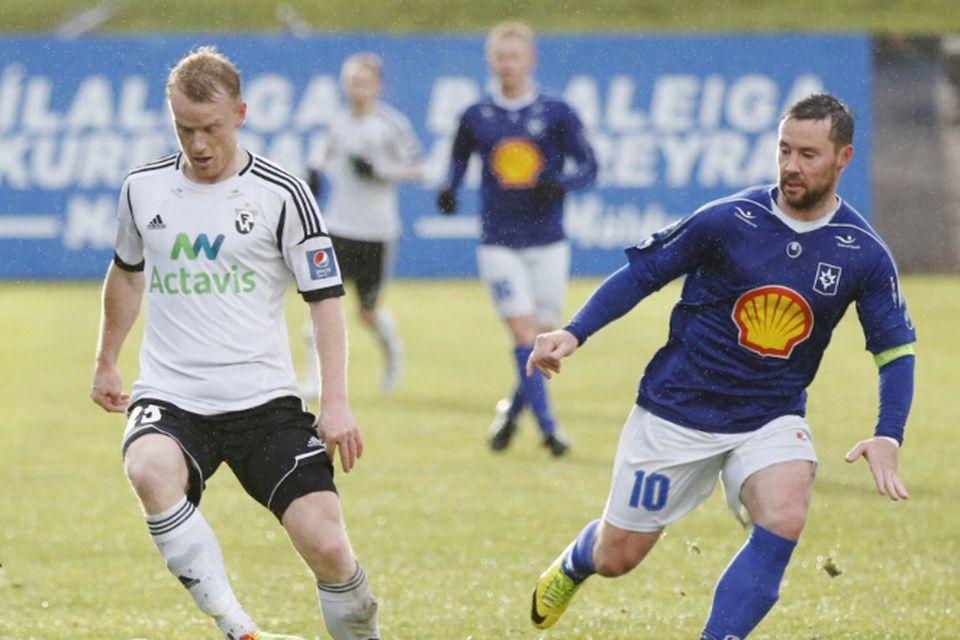 Hólmar Örn Rúnarsson og Veigar Páll Gunnarsson í leiknum í dag.