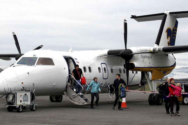 Passengers disembark from an Air Iceland branded Dash 8-300. Retrofitting these planes to run on …