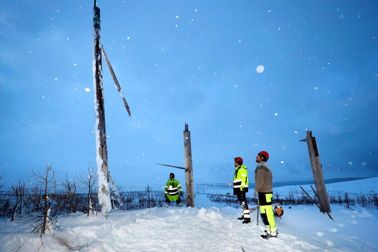 A crew from RARIK, working on repairs in December.