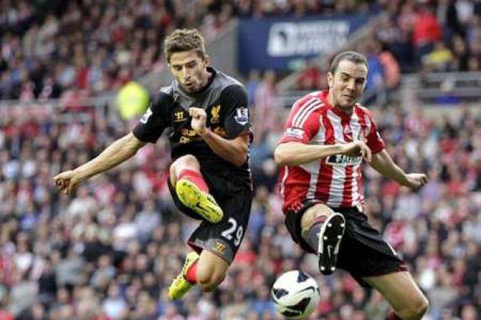 Fabio Borini, til vinstri, er kominn til Sunderland sem lánsmaður frá Liverpool.